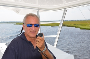 Yours truly making the call that will hopefully, get me out on this boat looking for deep waters and tight lines.