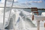 Boat wake from bridge
