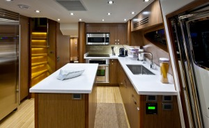 Wide open spaces and plenty of counter room will make the galley one of the centerpieces aboard this Hatteras Yacht.