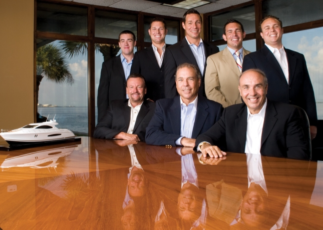 The Lazzara family boardroom with Dick (center) and Brad (right) surrounded by the next generation of yacht builders and designers.