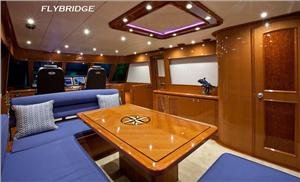 Sure to be a favorite 'hang out' space aboard whether underway or at a favorite anchorage, the bridge deck's lounge area is like having yet another fully functional entertainment space.