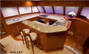 The fully equipped galley is laid out for ease of service for anything from a light snack to an eight course dinner.