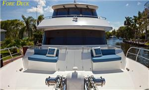 The expansive foredeck area offers comfortable seating just under the Portuguese bridge.