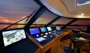 The expansive helm offers the captain all the room necessary for monitoring critical engine functions as well as any electronic displays and controls.