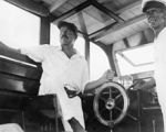 220px-Ernest_Hemingway_and_Carlos_Gutierrez_aboard_Pilar,_Key_West,_1934