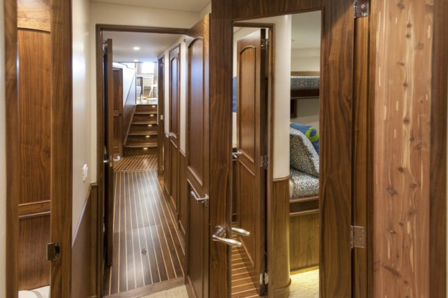 The interior hallway is only a prelude to what awaits the boat's owners and guests.